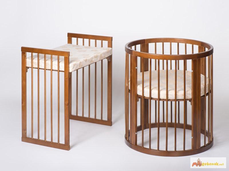 Круглая кроватка из натурального дерева