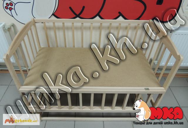 Фото 3. Детская кроватка - маятник без лака с откидной боковинкой
